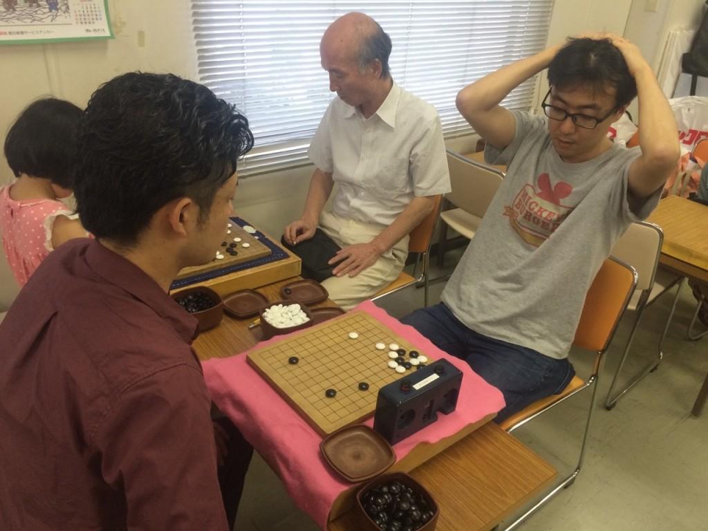 囲碁クエスト開発者の棚瀬さん。悩んでいる表情が伺えます。